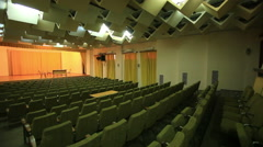 Back rows of seats in large hall for presentations Stock Footage