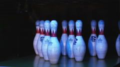 Bowling pins being knocked down by a bowling ball in a bowling alley Stock Footage