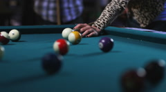 Young couple playing pool Stock Footage