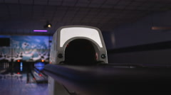 Bowling ball coming out of a ball return at an alley Stock Footage