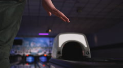 Man waiting for his bowling ball to come out of the ball return Stock Footage