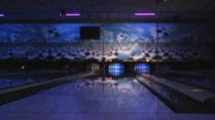 Camera following the flight of a bowling ball down a bowling lane towards the Stock Footage