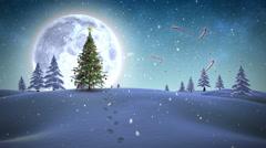 Feliz navidad message appearing in snowy landscape Stock Footage