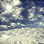 winter landscape with snow covered hill and blue sky - stock photo