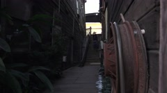 Early Chinese town of Locke, CA, cowboy walking Stock Footage