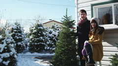 Young couple buying a Christmas tree Stock Footage