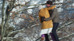 Young couple kissing in the snow Stock Footage