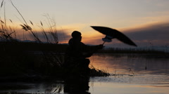 hunter using duck decoy and then shooting - stock footage