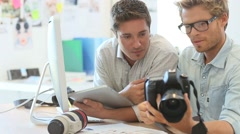 journalist and reporter working together in agency - stock footage
