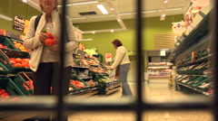 Elderly woman shopping at tesco supermarket, england Stock Footage