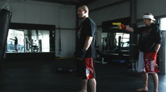 Two men practicing self-defense and martial arts in a gym Stock Footage