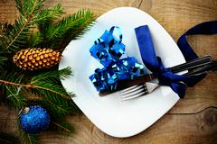 Decorate christmas plate with gifts and pines on wooden surface Stock Photos