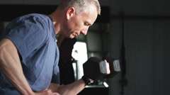 Man working out with dumbbells at the gym Stock Footage