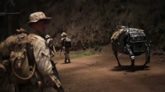 Marine LS3 robot patrols with Marines Stock Footage