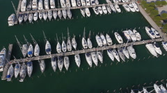 Stock Video Footage of Aerial - Marina full of sailboats, yachts and boats