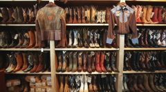 Wall of cowboy boots at a western wear store Stock Footage