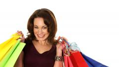 Woman holding shopping bags isolated on white walks in and out Stock Footage