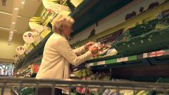 Woman shopping at tesco supermarket, england Stock Footage