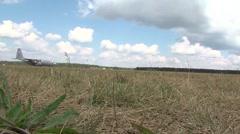 C-130 Hercules aircraft Grass Landings in Poland Stock Footage