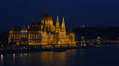 UHD tele night view of Hungarian parliament in Budapest Stock Footage