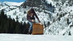 Mid adult couple sledding on toboggan Stock Footage