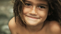 Boy with dreadlocks looking at the camera Stock Footage