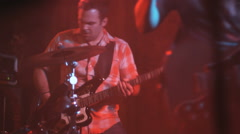 Singer and bass guitar player in a band performing on stage Stock Footage