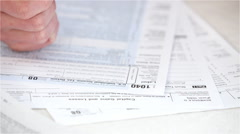 At home: anonymous woman writing information on tax forms Stock Footage