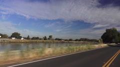 Driving Sacramento River levee Stock Footage