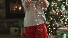 Man untangling Christmas tree lights Stock Footage