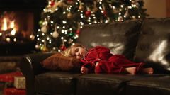 Father carrying father to bed after she fell asleep waiting for Santa Stock Footage