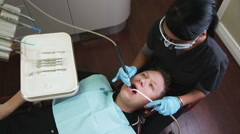 Dental hygienist working on a male patient Stock Footage