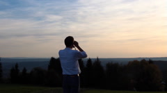 Man is looking with binoculars Stock Footage