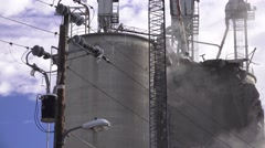 Wrecking ball, demolition of grain silo ,blowing dust Stock Footage