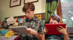 Video games addiction, brothers, boys, children with tablet computer Stock Footage