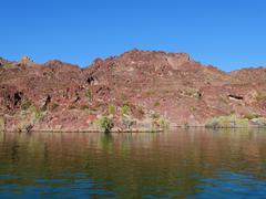 vibrant rocky mountain shore at lake - stock photo