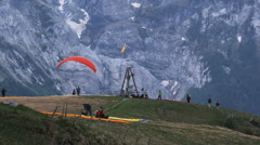 Paraglider taking off from a mountain top Stock Footage