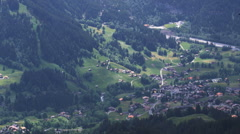 Paraglider soaring above an alpine valley Stock Footage