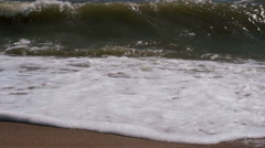 Turbulent water on a sandy coastline Stock Footage
