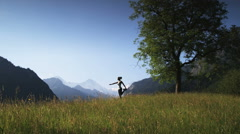 Woman practicing yoga in a mountain field Stock Footage