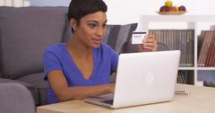 Happy black woman making an online purchase Stock Photos