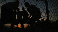 WS TU Men playing basketball at night / Salt Lake City, Utah, USA. Stock Footage