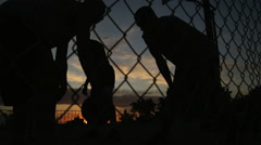 WS TU Men playing basketball at night / Salt Lake City, Utah, USA. Stock Footage