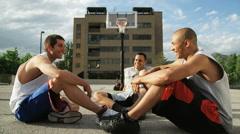 WS Men sitting and talking before playing basketball / Salt Lake City, Utah, Stock Footage