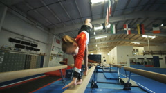 WS Girl (12-13) performing gymnastics on balance beam / Lindon, Utah, USA. Stock Footage