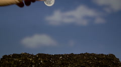 CU T/L Coin being planted and money growing Stock Footage