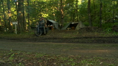 German motorcycle riders in forest WW2 Stock Footage