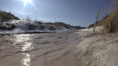 River & Stream Badlands National Park Winter Snowmelt Sun Flare - stock footage