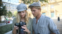 young photographers taking pictures in town - stock footage