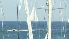 Sailing boats navigating close to Porto Cervo, Italy  Stock Footage